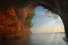 Landscape At Sunrise Of The Interior Of Cathedral Sea Cave With Sunbeams, Grand Island, Lake Superior, Michigan's Upper Peninsula, USA
