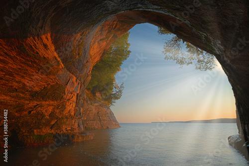 Fototapeta Landscape at sunrise of the interior of Cathedral Sea Cave with sunbeams, Grand Island, Lake Superior, Michigan's Upper Peninsula, USA obraz