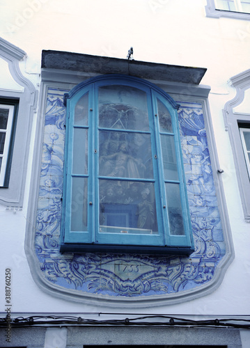 Fotomural Religious altarpiece of ceramic tiles on a street in the historic center of the