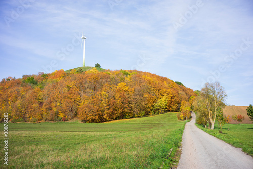 Fotografiet Wind turbine on an artificial hill built from the ruins and rubble from World Wa