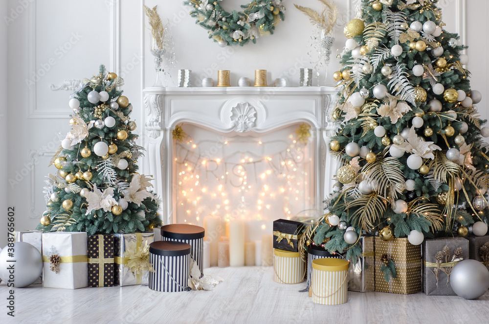 Fototapeta New Year decorated interior - bright living room or hall with Christmas decoration - fir-tree, gift boxes, fireplace decorated with garlands - hoilday celebration photo