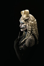 Portrait Of A Young Woman Wearing Halloween Makeup On A Black Background