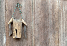 Wood Cow Bell Hanging On Woode...