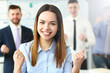 Leinwandbild Motiv Smiling beauty businesswoman office portrait standing on group business peoples background. Demonstrates joy winning end reporting period education completion affairs and energy concept