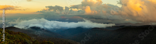 Fotografie, Obraz Panorama of the Blue Ridge Mountains at sunset with fog and clouds
