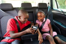 Brother And Sister Using Smart...
