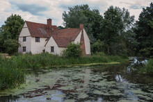 "Willy Lotts Cottage In Dedham Vale, UK Was Made Famous By John Constables Painting ""The Haywain"""