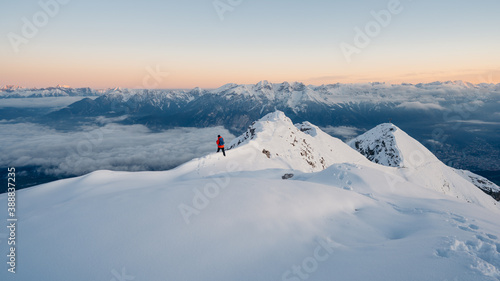Foto Panoramic banner of man trekking in snow covered mountain