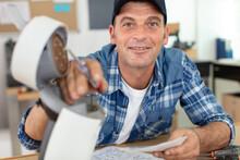 Friendly Man Repairing Broken ...