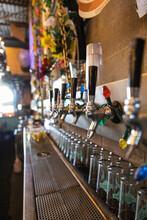 String Lights Hanging Over Beer Taps In Brewery