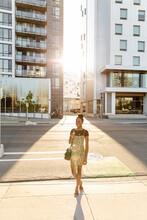 Portrait Stylish Young Woman On Sunny City Sidewalk