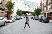 Stylish Young Man With Smart Phone Crossing City Street