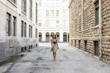 Stylish Woman Walking In City ...