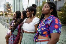 Stylish Young Women Friends On City Bridge