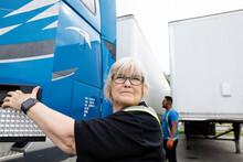 Warehouse Worker Opening Door Of Container Truck