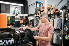 Man Shopping For Clothing In S...