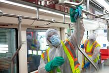 Male Transit Worker Sanitizing...