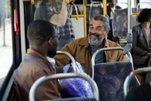 Happy Male Passengers Talking ...