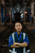 Portrait Of Woman Standing On Railroad Track In Subway Train Workshop