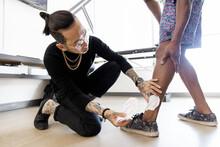 Tattoo Artist Holding Template...