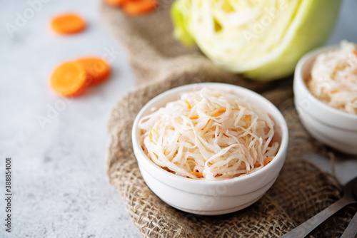 Tela Fresh raw pickled cabbage with casrrot in a white bowl
