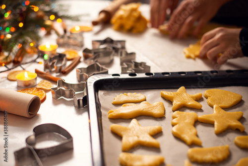 Raw shortbread of different shapes on a baking sheet in the kitchen Fototapet