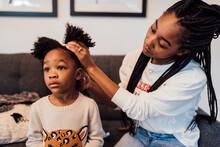 Mom Combing Daughters Hair