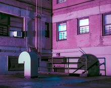 Industrial Pipes Outside Building At Night