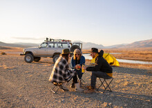 Friends Enjoying Picnic, Drinking Hot Beverage From Thermos (coffee, Tea)