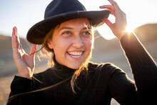 Beautiful Portrait In The Sunshine Of A Young Laughing Girl In A Felt Hat