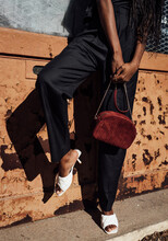 Woman With Purse And White Heels