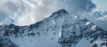 An Alpine Mountain Range Covered In Snow In Lenzerheide, Switzerland.