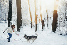 Girl Playing With Her Dog.