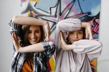 Cheerful Girls Making Differen...
