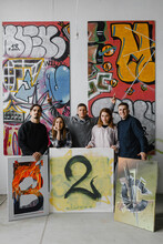 Group Of Artists Present Picture—ñ In Gallery.