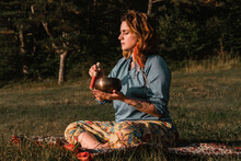 Young Woman Practicing Spirituality And Healing