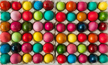Multicolored Easter Eggs In The Package On The White Background. Copyspace. Still Life Photo Of Lots Of Colorful Easter Eggs.Background With Easter Eggs. Easter Photo Concept