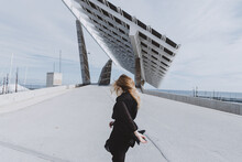 Fashionable Woman Walking Through Bridge.