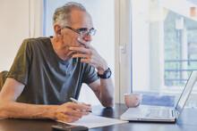 Elderly Senior Man Working On ...