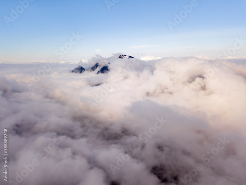 Andean mountain peaking above clouds, view from Huayna Potosi mountain, Bolivia
