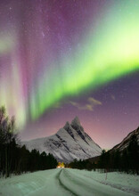 Aurora Borealis Above Mountain