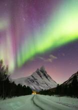 Aurora Borealis Above Mountain