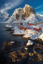 Panoramic View Of A Norwegian Village With A Large Snow-capped Mountain In The Background