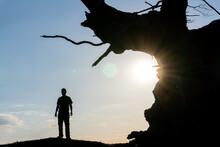 A Man Standing Underneath An A...