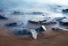 Misty Waves On The Rocks