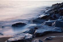 Misty Waves On Rocks