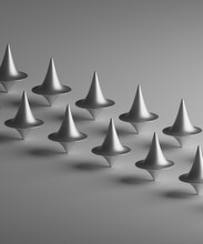 Three Dimensional Render Of Rows Of Metallic Spinning Tops