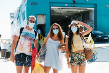 Friends Wearing Masks Standing Against Cruise Ship At Harbor