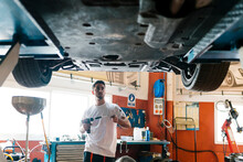 Young Mechanic Holding Work To...
