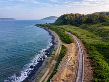Aerial View Of Empty Railroad Tracks Stretching Along Coast Of Sea Of Japan